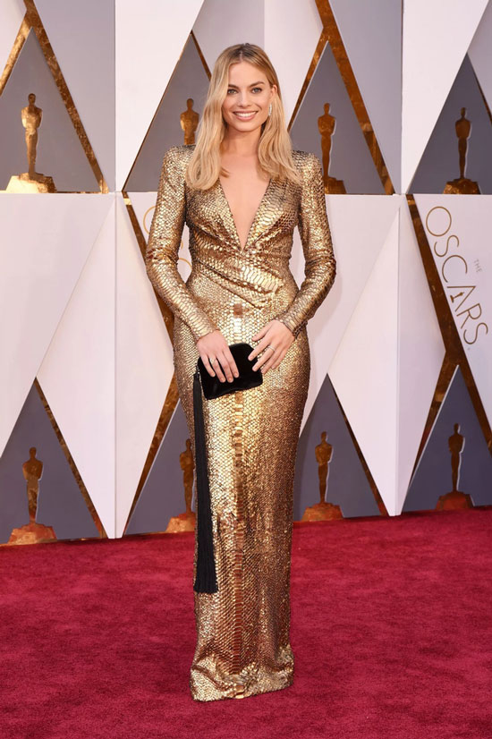 Margot Robbie in a gold dress at the Oscars